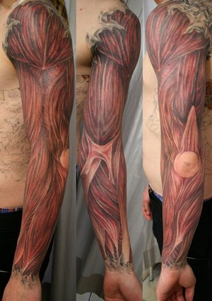 muscle tattoo. Brain tattoo