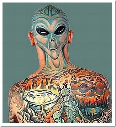 it seem that the tattoo is a face. My favorite is the guy with the alien